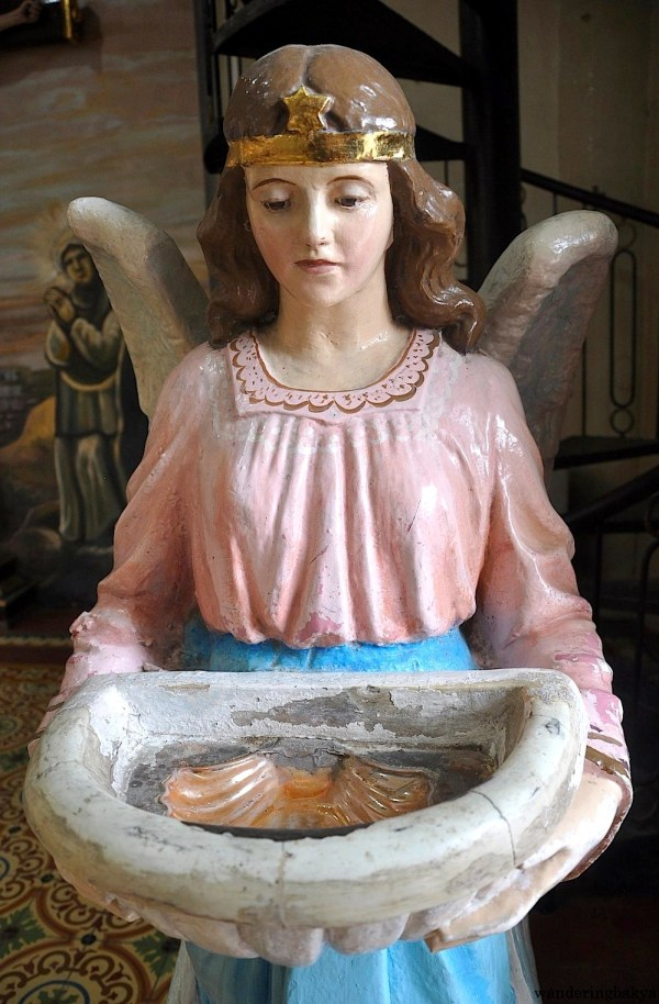 This angel greets every parishioner at the entrance of the church