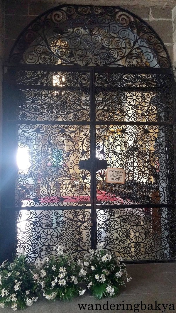 This intricately-designed door leads to the altar of San Agustin Church.