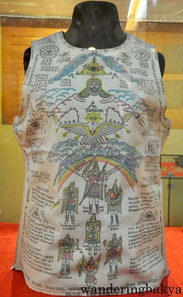The katipuneros, who might have thought that their bolos were not enough to ward off the Spaniards or it might be due to unrelenting belief in paganism, wore anting-anting (amulets). This one is a hand painted cloth vest with all-seeing eye designs among other things.