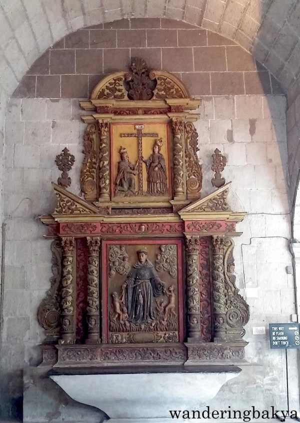 If I recall correctly, this is a retablo of San Nicolas de Tolentino (who happens to be the patron saint of my native town). This is found to the left of the door mentioned above.