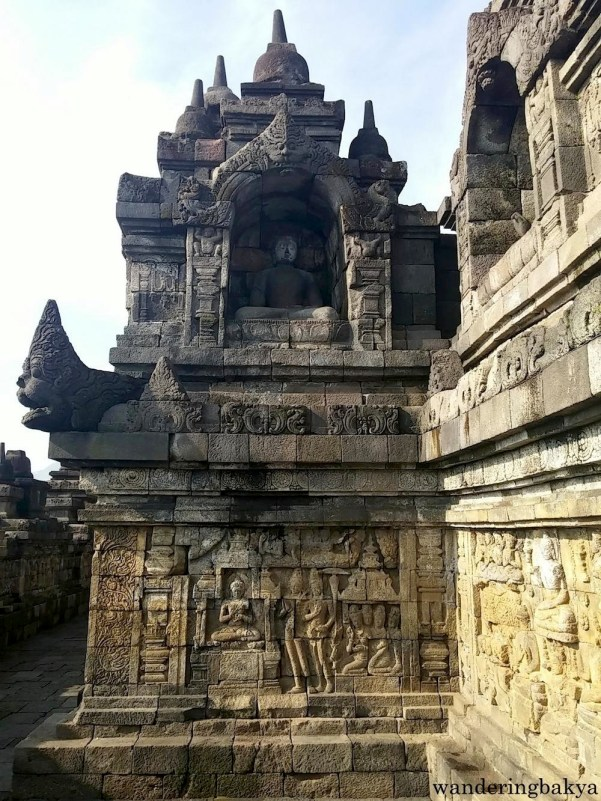 Borobudur has hundreds of Buddha statues, one of them is pictured here.