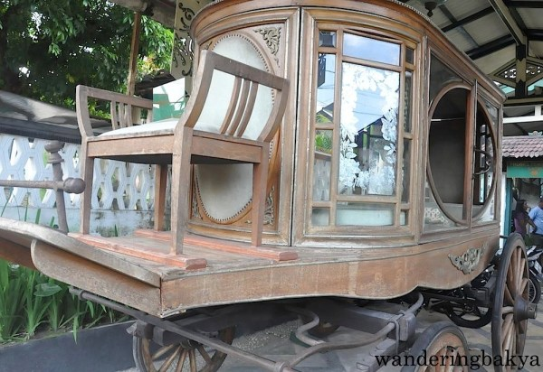This is a wedding carriage. This was parked in the driveway of the batik store where we stopped for a side trip.