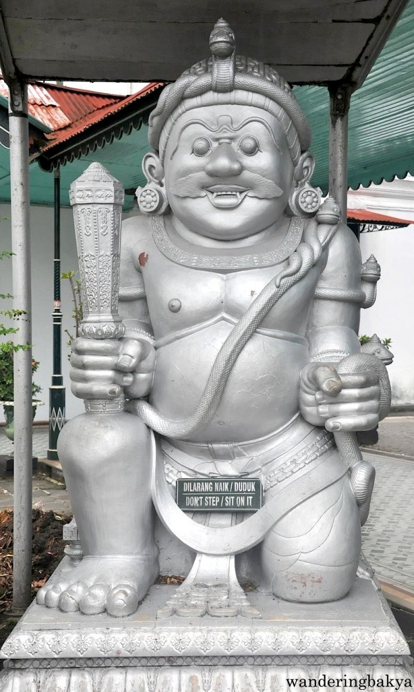 This statue is found to the left of the main hall. Its twin statue is to its right.