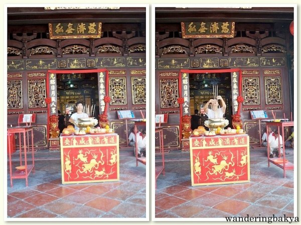 A man performing a ceremony in one of the temples in Jonker Walk.