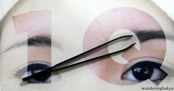 Tweezers or pincers on top of the cover of Haruki Murakami's 1Q84.