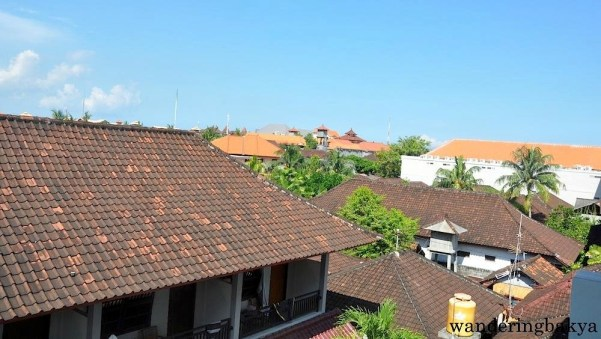 The roofs of the houses in Bali (and in some parts of Jakarta, I did not notice if this was true in Yogyakarta)  had an almost uniform look. The roofs have sirap or hard wood shingles arranged like tiles. This photo was taken from the balcony of our third-floor room in Ronta Bungalow.