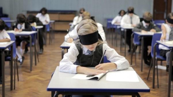 Marie taking the test blindfolded. Photo from diaboliquemagazine.com.