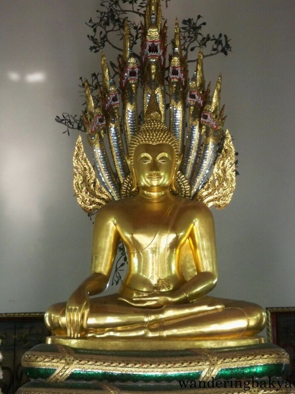 Monument of Buddha. Buddha is sitting under a seven-headed naga and in meditation