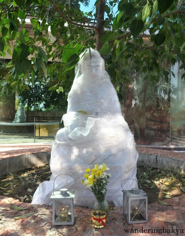 Wrapped Buddha (cleaning of Wisdom Park was in progress when I dropped by) under a Bodhi tree.