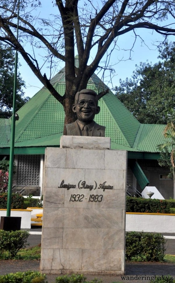 """Bust of Benigno Simeon """"Ninoy"""" Aquino, Jr welcomes visitors to the park"""
