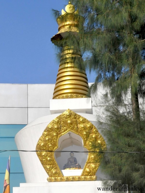 The Buddha inside the stupa, as seen from across the street