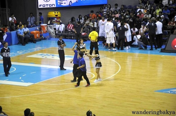 T-shirts whiz through the air into the waiting hands of PBA fans.