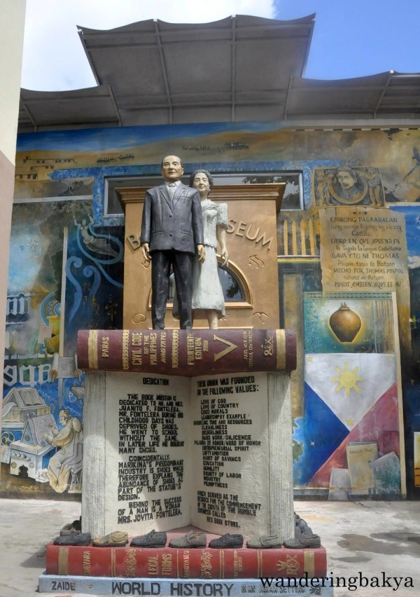 In front of the door of The Book Museum is the statue of Mr. and Mrs. Juanito Fontelera, the mother and stepfather of Atty. Dominador Buhain. The statue is by Rizal artist Roger Baldono.