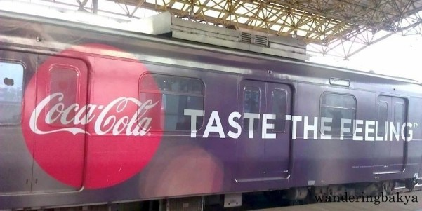 """The first time I posted the """"Taste the Feeling"""" Coke ad from last cycle, I failed to take a proper photo of it. Now I have the whole imperative sentence and the logo. In one photo. Success!"""