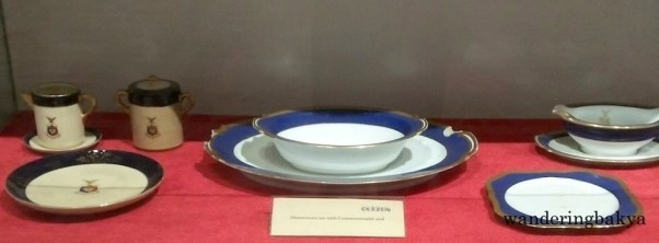 Dinnerware set with Commonwealth seal.