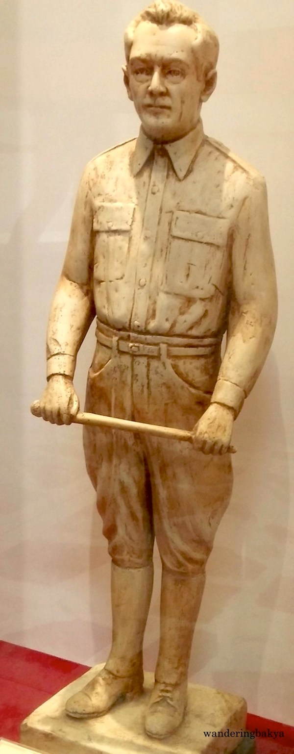 Statuette of President Manuel L. Quezon with swagger stick