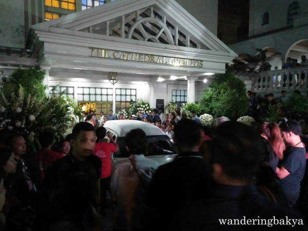 The hearse containing Senator Miriam Defensor-Santiago made its way slowly from the chapel to the cathedral.