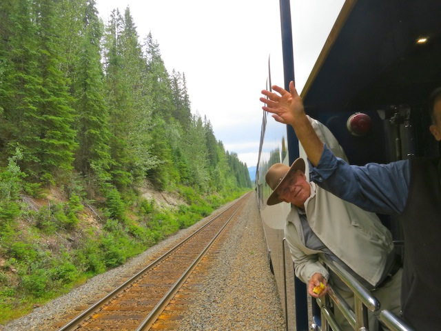 People waving on the Rocky Mountaineer scenic train