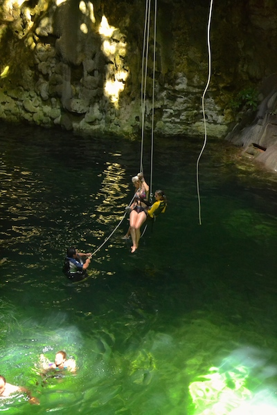 Rappelling into the Cenote Maya Mexico