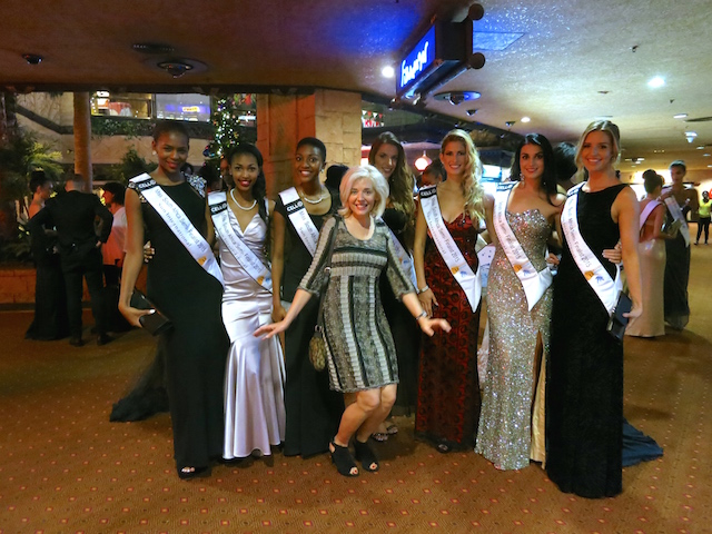 Wandering Carol, luxury travel blogger, photo bombing Miss South Africa contestants