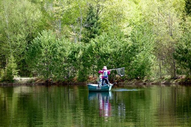 Netting a fish on Canada fishing trip