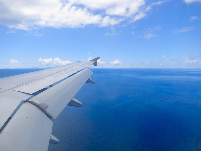 Travel advice for Canadian Snowbirds, photo of plane wing