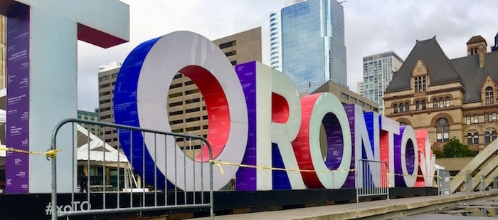 Big neon sign of Toronto in Nathan Phillips Square