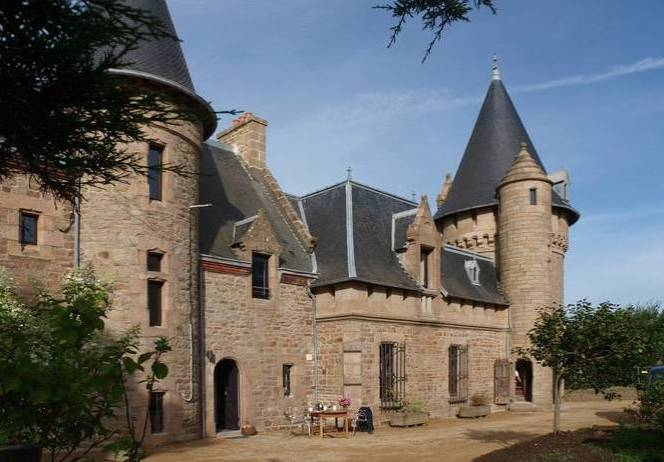 Turrets and stone exterior of chateau rental in France Marmousets Castle