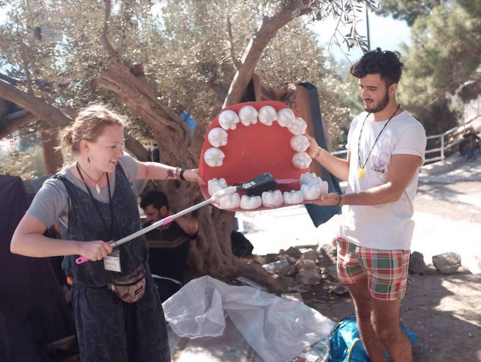 Teaching kids how to brush their teeth.  Volunteering in a refugee camp in Europe.