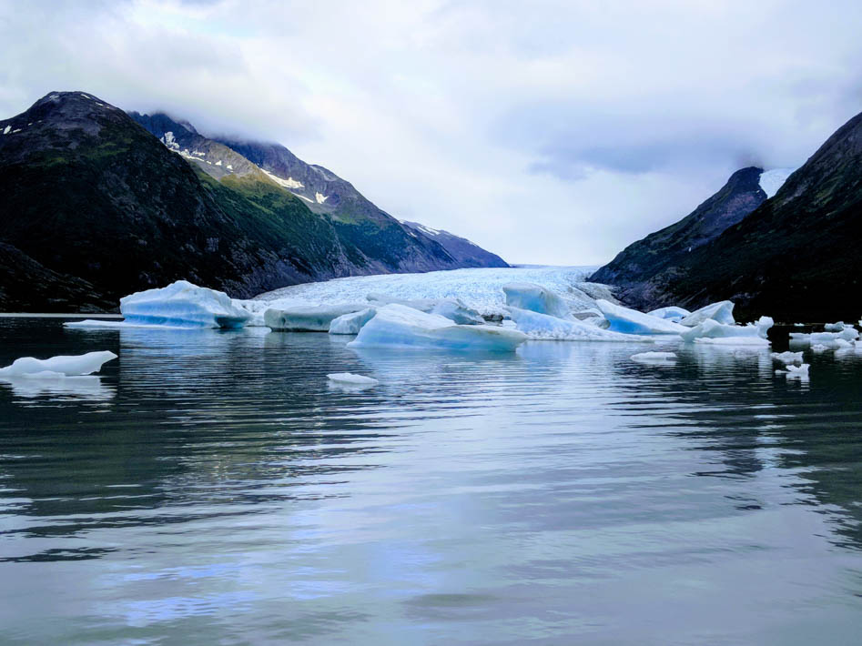 glacier calving into a lake