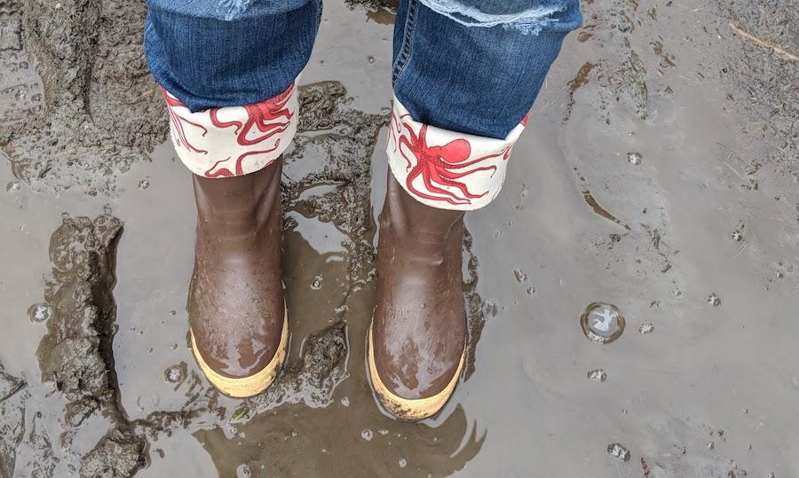 Designer rain boots in the mud