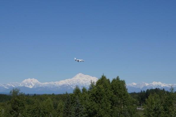 An Airplane flies over Mt. McKinley