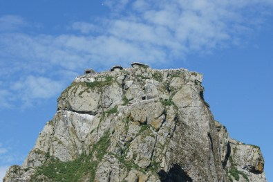 The buildings on the top of this rock are bunkers from WWII
