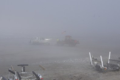 Bringing in another boat. It was so foggy we couldn't even see the water.