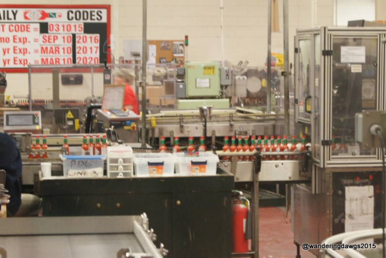Original Tabasco sauce going down the assembly line