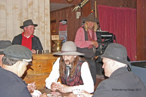 Reenactment of the shooting of Wild Bill Hickock (with the long hair and mustache playing cards)