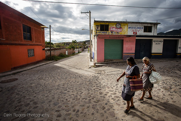 Two women walk through the otherwise deserted and quiet streets of Mitla, Mexico.
