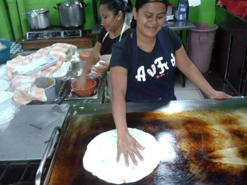 A pupuseria in El Salvador. Making a Pupusa Loca