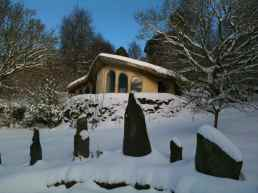 Cob Cottage and Stones in the snow