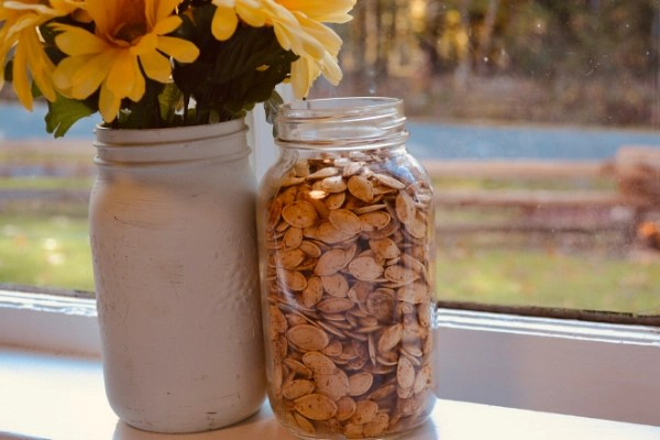 Roasting Pumpkin seeds is an absolute must when dealing with your pumpkins this year. Save the seeds when carving your Jack-O-Lanterns and  enjoy this healthy crunchy snack by following this super easy step-by step guide to roasting pumpkin seeds.