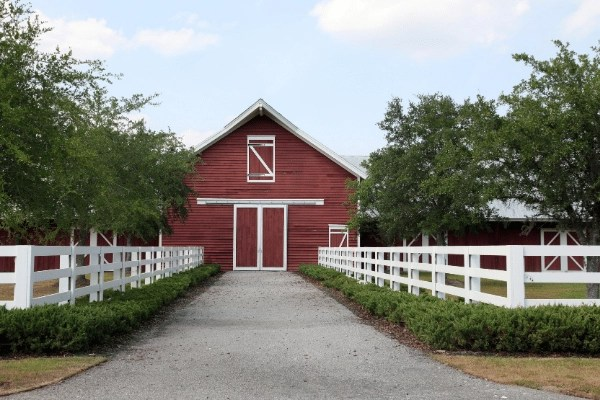 horse stable and white fence