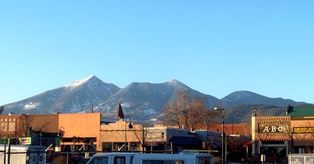 Downtown Flagstaff with San Francisco Peaks in Background - Photographer unknown