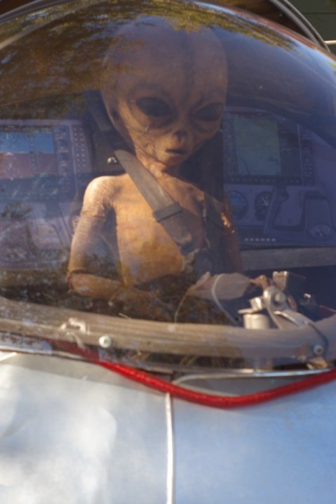 An alien on his way for a probing housecall.