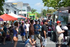 Hunt Street bustling with people. Food trucks, Vendors, and Vega Metals are all located here.