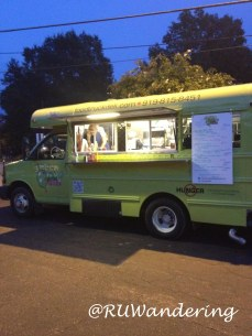 Green Olive Deli Food Truck parked at Person Street