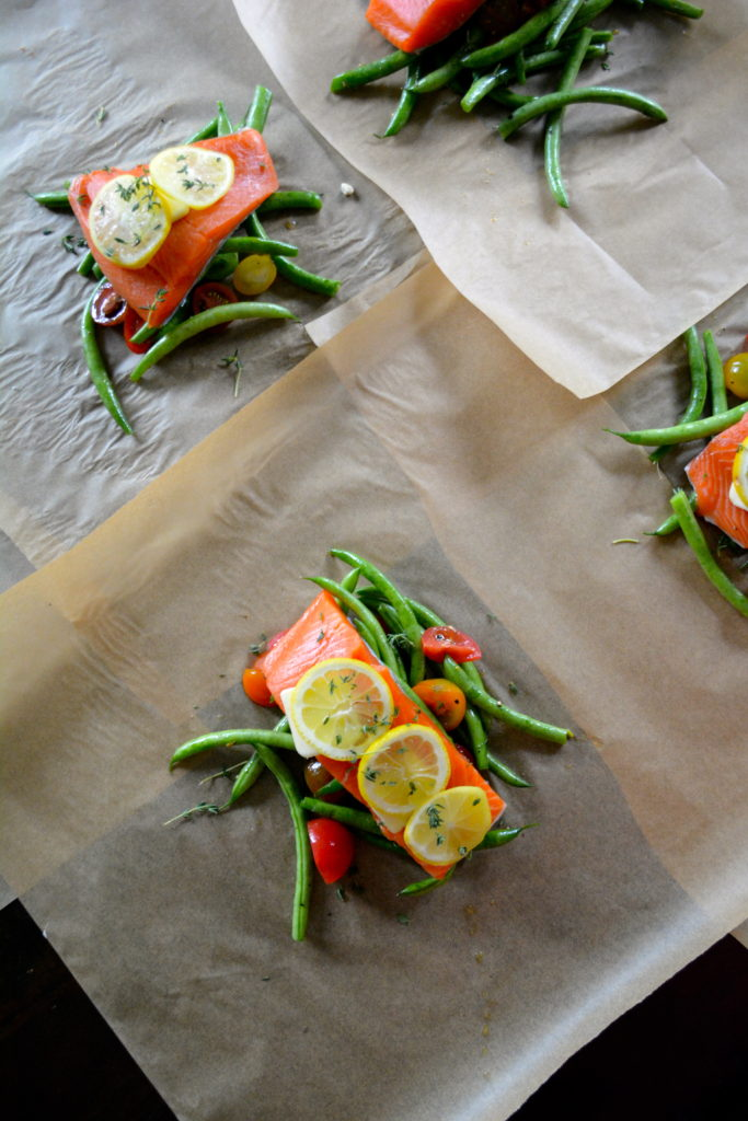Salmon en Papillote - salmon filets with lemon, thyme, green beans, and tomatoes