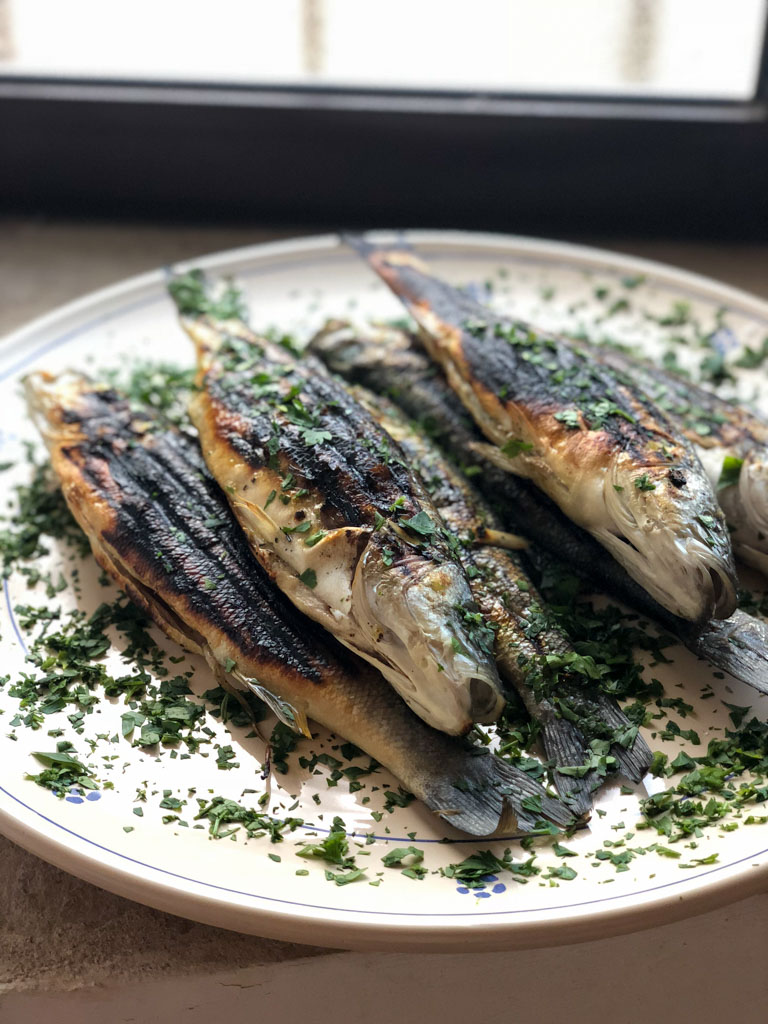 Fresh fish with parsley and olive oil at the Awaiting Table Cooking School in Puglia, Italy