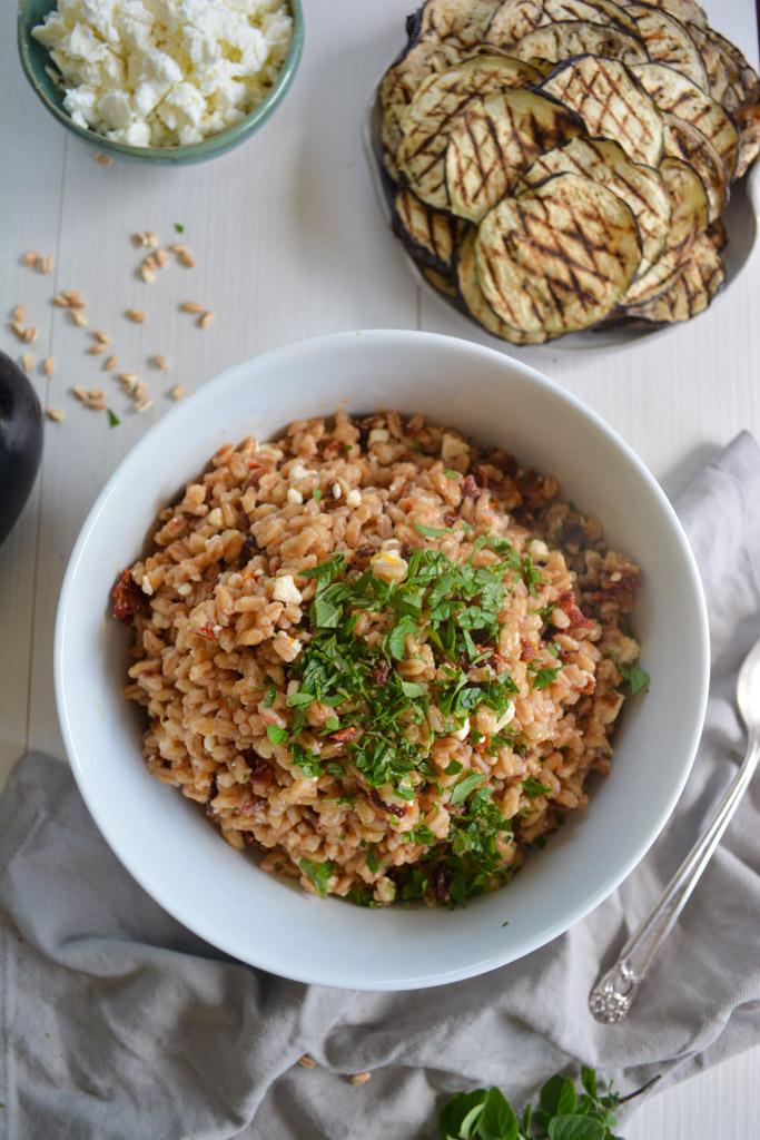 Charred Eggplant with a zippy Mediterranean Farro Salad - a perfect hearty, vegetarian meal