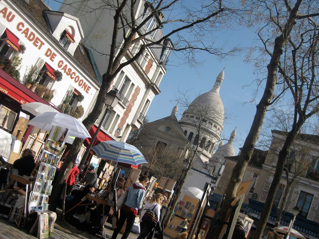 Comprehensive Guide to Paris:  Place du Tertre with Sacre Coeur Basilica in the background