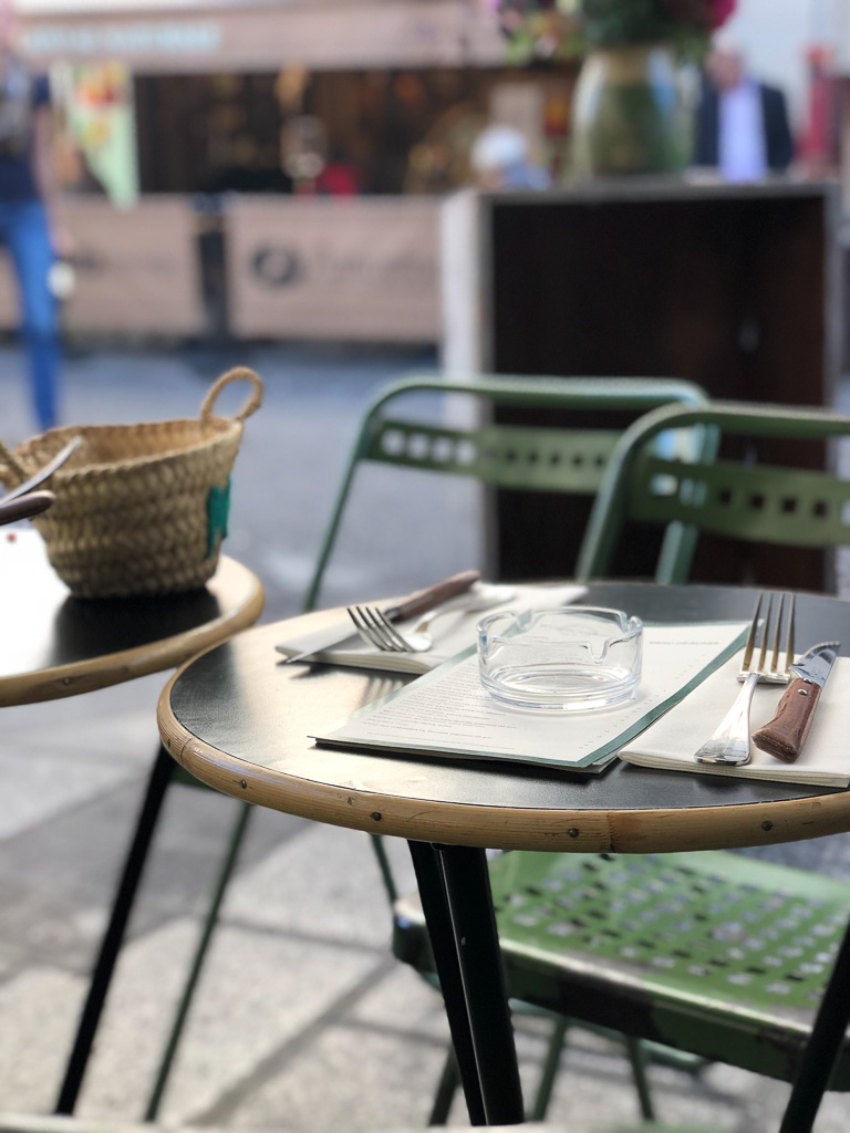 Comprehensive Guide to Paris:  Bistro chairs set up at an outdoor cafe